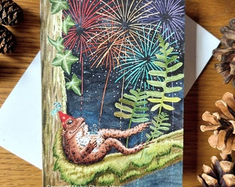 Greetings card x3: Toad watching fireworks with glass of bubbly