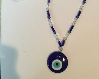 Long blue necklace with evil eye pendant