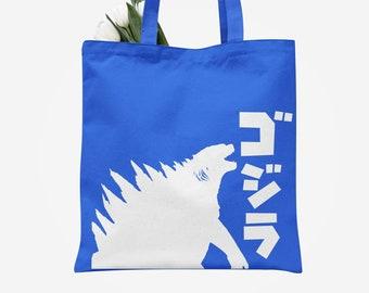 Godzilla and original typography on blue tote bag
