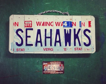 Seahawks. Seattle. License plate. Football. 12th man. Hawks. Sports. Sports team. Washington. Sign. Garage. Den.