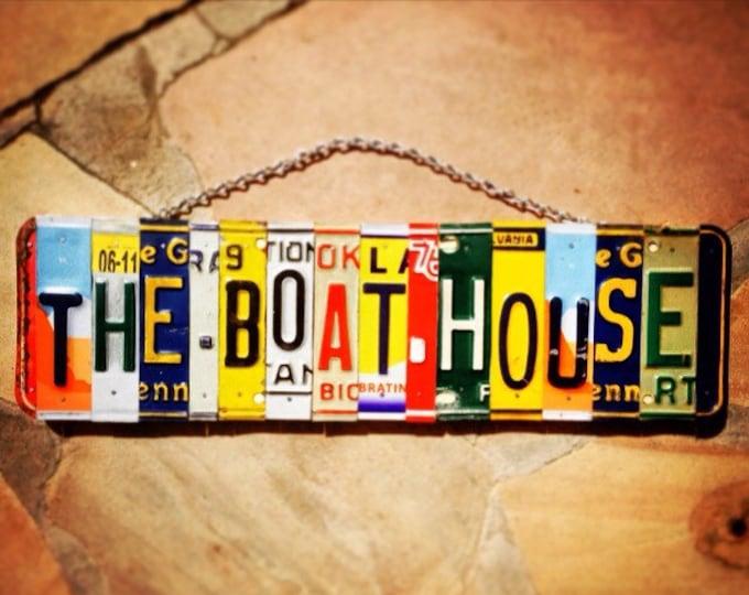 The boat house. Boat. Boating. Lake. Lake House. River. Cabin. Boat house. House boat. Boater. Lake cabin. License plate. Art. Handmade. Car