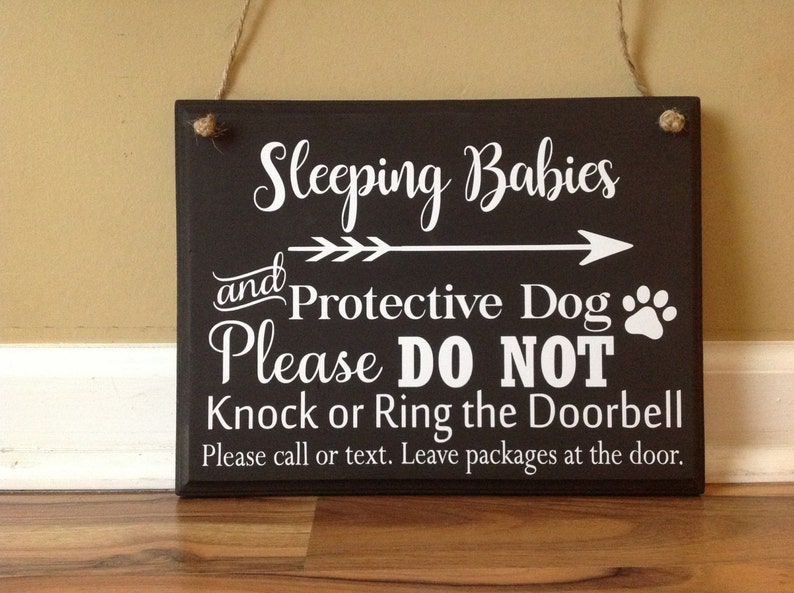 Sleeping Babies and Protective Dog Please Do Not Knock or Ring Doorbell Please call or text Leave packages hanging door sign brown white
