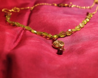 Peridot necklace with garnet drop