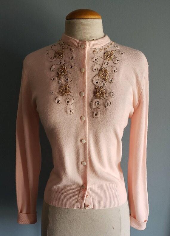 1950s pink beaded cardigan sweater.