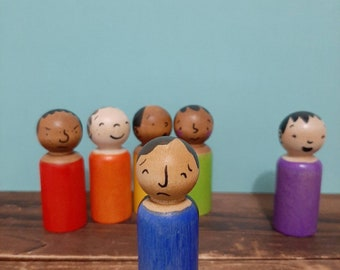 Feelings Wooden peg dolls in multicultural and rainbow colours with 6 different emotions.  For emotional development and loose parts play.