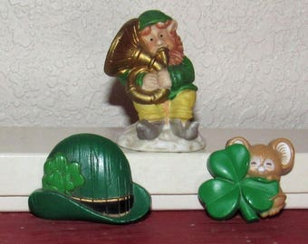 """St. Patrick's Day Pins and Little Ceramic Lephrechaun Figure, 1 3/8"""" tall to 2 1/8"""" tall"""