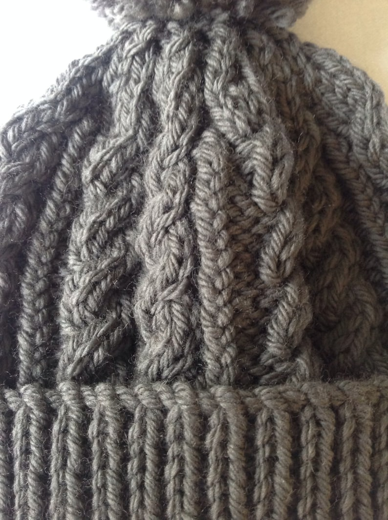 range of sizes available from 0-3 to 24 months on trend for autumn 2014 Charcoal grey hand knitted aran beanie bobble hat