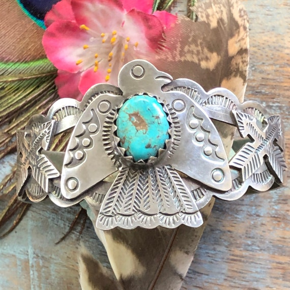 Sterling turquoise thunderbird cuff