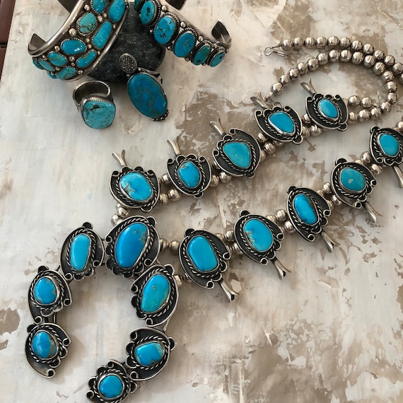Superb Turquoise and sterling squash blossom necklace