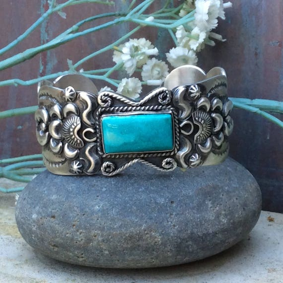 Magnificent turquoise and  sterling Navajo repousse hand stamped cuff