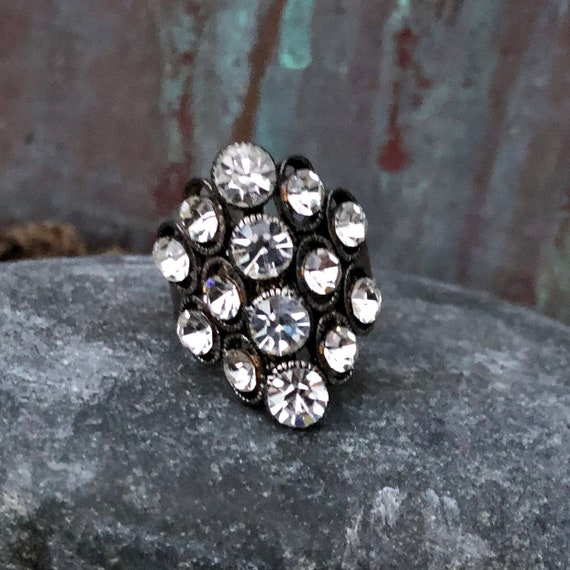 Vintage rhinestone and silver alloy ring adjustable currently a size 7.5