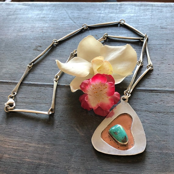 A beautiful handmade studio sterling,copper and turquoise necklace