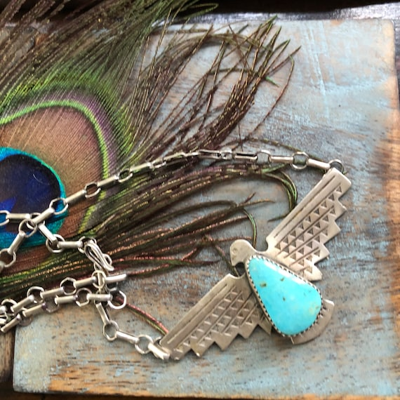 Turquoise sterling thunderbird necklace