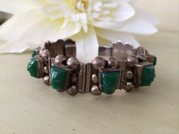 Taxco sterling and jade carved faces bracelet