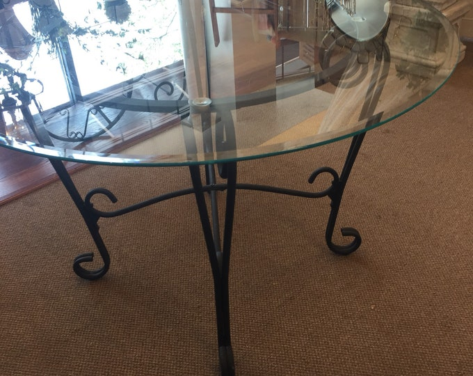 Vintage round glass and wrought iron table