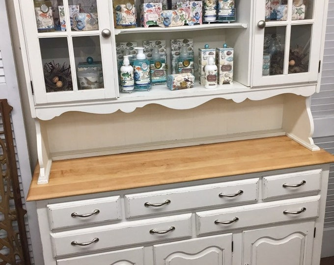 Vintage white cuboard with glass doors