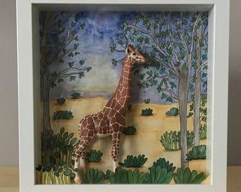 Setting diorama featuring original hand painted and miniature of a giraffe.