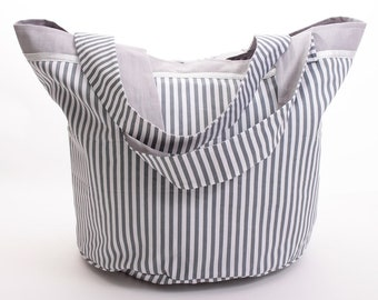 White and grey striped round bag