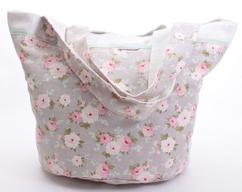 Round bag with pink flowers on gray background