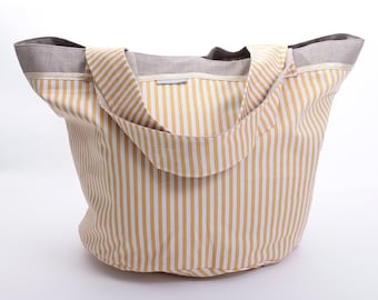 Round bag with white and mustard stripes