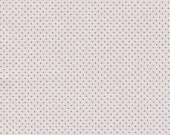 Tilda fabric of cream cotton and blue mini peas