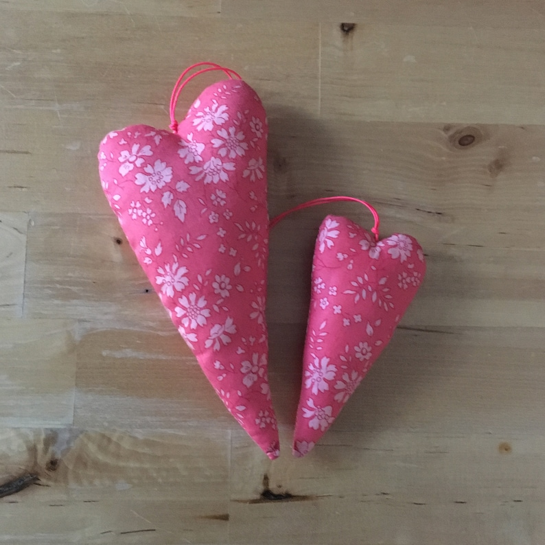 Duo of decorative hearts made from Liberty Capel coral fabric image 0
