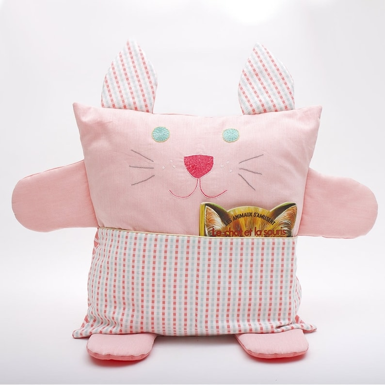 Peach pink organic cotton embroidered cat cushion image 0