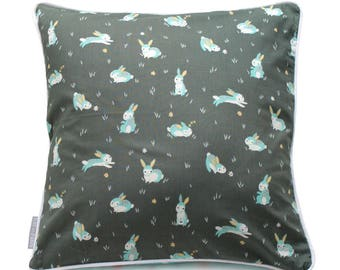Cushion gray and small turquoise rabbits