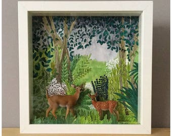 Setting diorama featuring original hand painted and miniature of a DOE and her fawn.