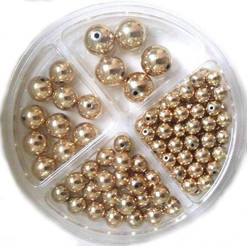 RICO Plastic Bead Set 97-piece Gold image 0