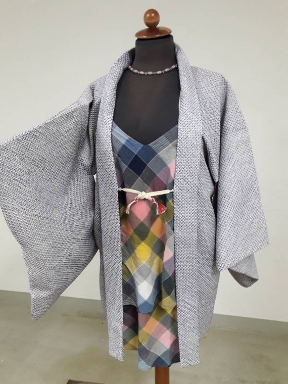 Pale blue tie-dye kimono jacket, shows an boho sty