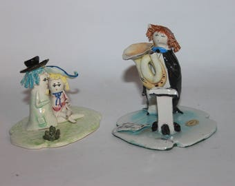 Pastelceramica Lino Zampiva, two vintage figures, musician and young lovers, slight damage