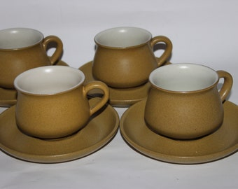 Four Denby Ode teacups and saucers, 1960s tableware, ochre mustard gold colourway
