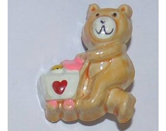 resin brooch with a teddy bear