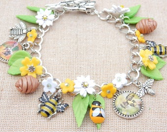 Bee bracelet, spring bracelet with bee charms and handmade flowers and bee cabachons