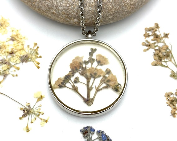 Dry Flowers necklace with resin botanical pendant and silver tone steel chain