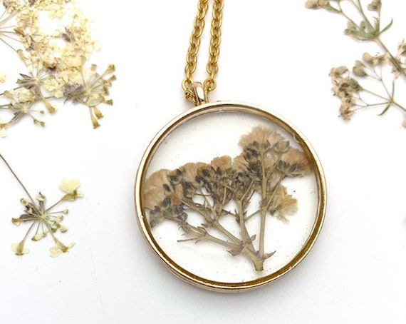 Dry Flowers necklace with resin botanical pendant and gold tone steel chain