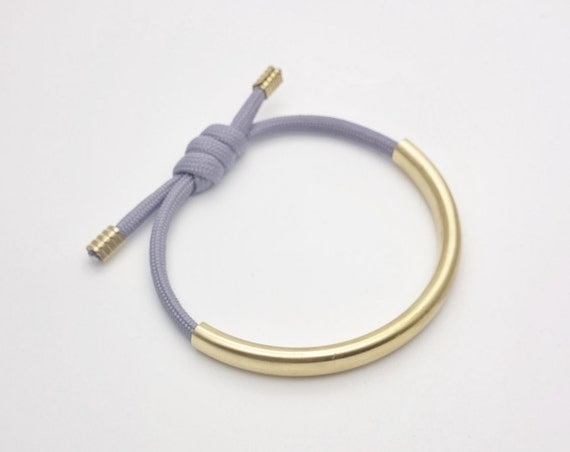 Tube and Rope bracelet Grey cord and gold raw brass tube adjustable and hypoallergenic