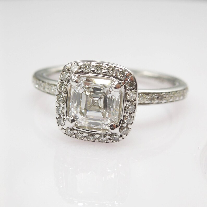 9278317b18adc 0.78ct Square Emerald Cut Diamond with Halo in 18K White Gold