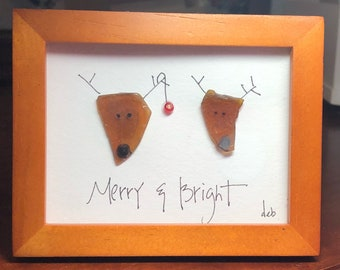 Merry and Bright - an original design using sea glass to create two whimsical reindeer, named Merry and Bright, with hand lettering