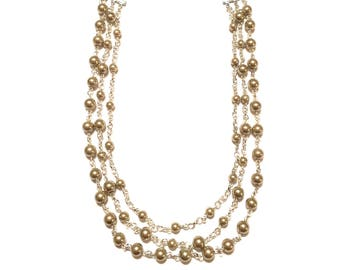 Necklace. 3 strands of Glass Pearls