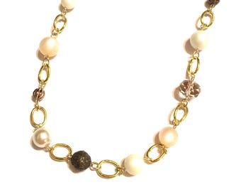 Necklace. Gold. Neutral colors. Long.