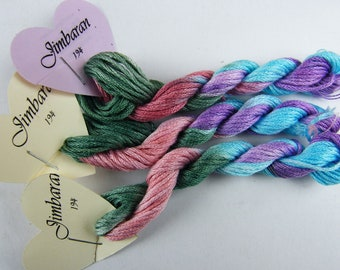 194 Jimbaran - hand dyed stranded cotton by Fils à Soso. Variegated yarn in blue, mauve, pink and green.