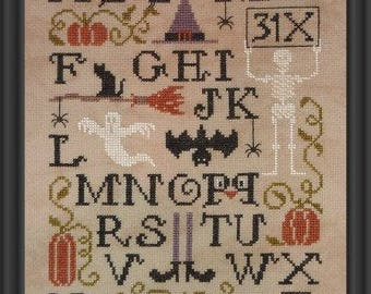 ABC Halloween Sampler – stitch this counted cross stitch chart for Halloween.
