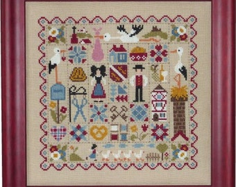 Alsace Patchwork – counted cross stitch chart to work in 12 colours of DMC thread. Traditional style patchwork and Alsace motifs.