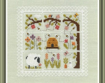 Colours in my Garden counted cross stitch chart to work in 11 colours of DMC thread. 9 square motifs with a lace style border.