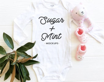 Download Free White Baby Bodysuit Mockup, Long Sleeve Baby Flat Lay PSD Template