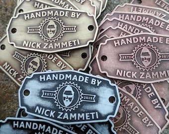 Zinc metal labels with relief for marking your products. Set 100 pcs.