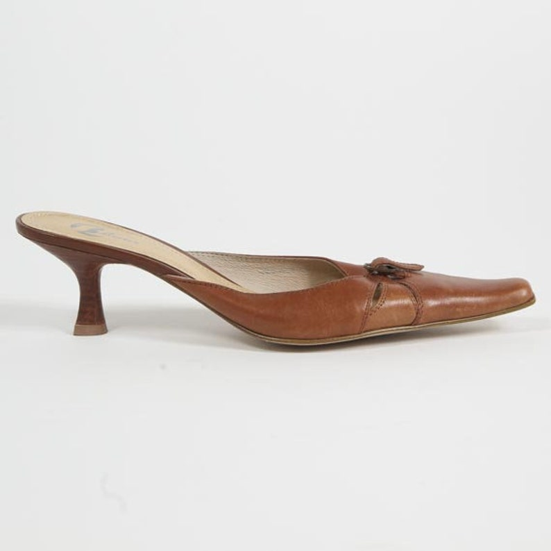 2447e3246b694 1990s Brown Mules - Vintage 90s Leather Bata Buckle Kitten Heel Sandals Cut  Out Pointed Toe Slip On Made In Italy Shoes Size EU 38 US 7 5