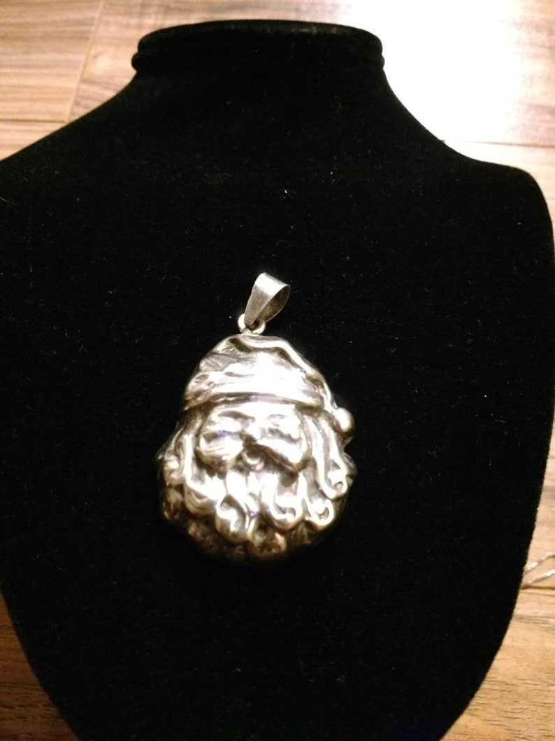 Sterling silver hollow puffy Santa Claus pendant